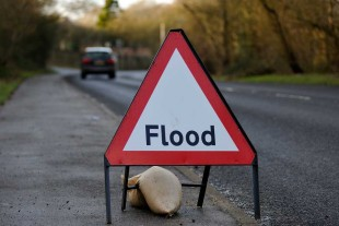 Flood sign on country road