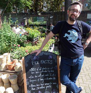 David Buck and Bees' Needs sign