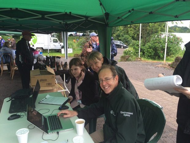 Environment Agency CEO Sir James Bevan testing a pilot version of the 'I want to Fish' digital service