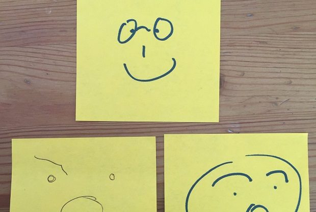 Post it notes with faces on them