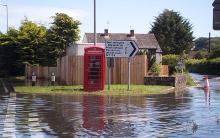 Flooding in front of a red telephone box