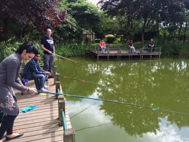 Members of the rod licence team on a fishing trip to learn more about users