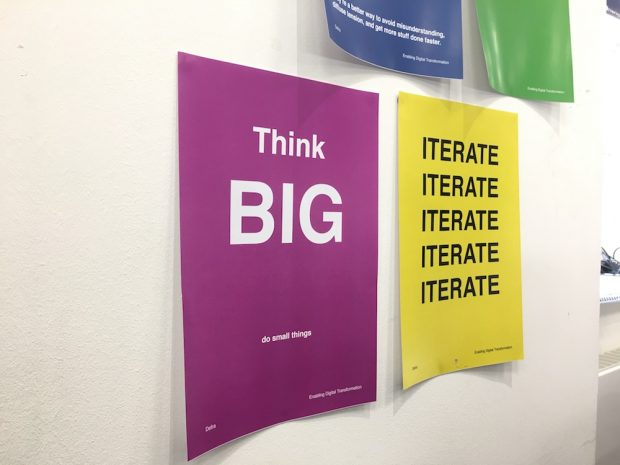 "Poster saying ""Think big, do small things"" on the wall in the Defra office"