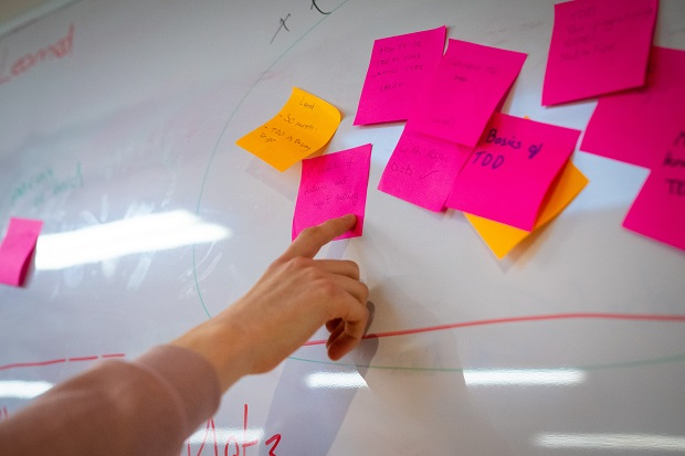 Post it notes on a board